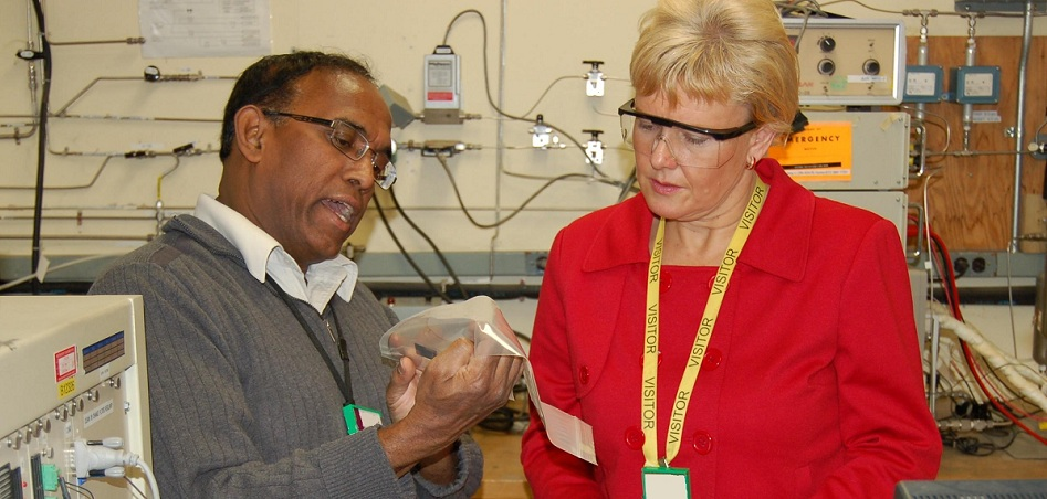 Sam Suppiah of AECL and Cheryl Gallant inspect a hydrogen fuel cell